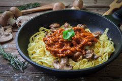 Italian fresh pasta. Fresh egg tagliatelle italian homemade pasta with bolognese sauce Stock Image