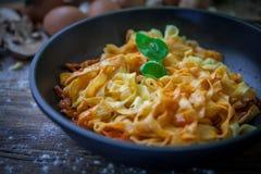 Italian fresh pasta. Fresh egg tagliatelle italian homemade pasta with bolognese sauce Royalty Free Stock Image