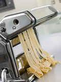 Fresh Egg Tagliatelle in a Pasta Machine Stock Images