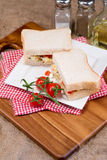 Fresh egg and tomato on white sandwich in rustic kitchen setting Royalty Free Stock Image