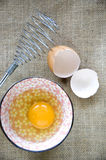 Fresh egg with whisk Royalty Free Stock Images