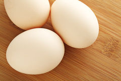 Fresh egg on wooden table. Fresh egg on the wooden table Royalty Free Stock Photography