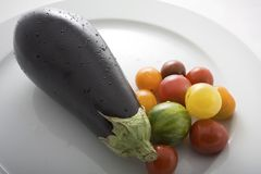 Fresh Eggplant and Wild Tomatoes Stock Image