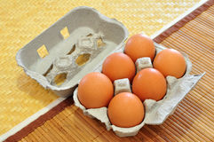 Fresh eggs. Paper box of fresh eggs over rustic background stock photography