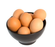 Fresh Eggs. In a black china bowl isolated over white background Stock Photography