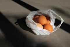 Fresh eggs in plastic bag Stock Photo