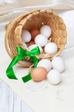 Fresh eggs in a basket Stock Photos