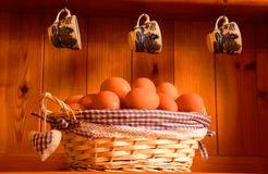 eggs in a basket on a dresser Stock Photo
