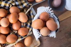 Fresh eggs in basket on table prepare eggs for cooking. Or bakery can use for background or wallpaper stock images