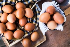 Fresh eggs in basket on table prepare eggs for cooking. Or bakery can use for background or wallpaper royalty free stock photos