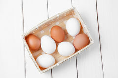Fresh eggs in a basket on a wooden background. horizontal shot Stock Image