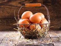 Fresh eggs in a basket Royalty Free Stock Images