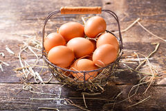 Fresh eggs in a basket Royalty Free Stock Photography