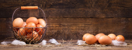 Fresh eggs in a basket Royalty Free Stock Photos
