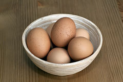Fresh Eggs in a Bowl. On table Royalty Free Stock Image