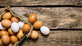 Fresh eggs from the box. On wooden table. Fresh eggs from the box. On a wooden table. Free space for text . Top view Royalty Free Stock Photo