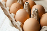 Fresh eggs in a cardboard tray Royalty Free Stock Images