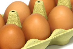 Fresh eggs in a carton. Fresh eggs in a carton, close-up Stock Image