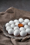 Fresh eggs collected on a tray for cooking on the fabric. Royalty Free Stock Images
