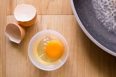 Fresh eggs in a cup and egg shell, pan Royalty Free Stock Images