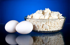 Fresh eggs and curd on a dark blue Stock Photos