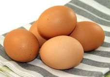 Fresh eggs on dishcloth Stock Photo