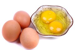 Fresh eggs and egg yolks royalty free stock images