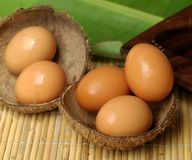 Fresh eggs from the farm. Fresh eggs in coconut shell Royalty Free Stock Image
