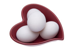 Fresh Eggs in a Heart Shaped Dish Royalty Free Stock Image