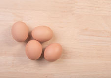 Fresh eggs ingredient on a wooden table. Rustic background Royalty Free Stock Image