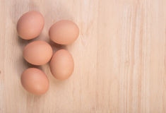 Fresh eggs ingredient on a wooden table. Rustic background Stock Photos