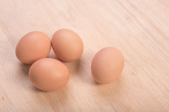 Fresh eggs ingredient on a wooden table. Rustic background Stock Image
