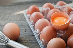 Fresh eggs with one cracked open ready to cook with Royalty Free Stock Photo