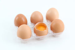 Fresh eggs, one open, on white Royalty Free Stock Images