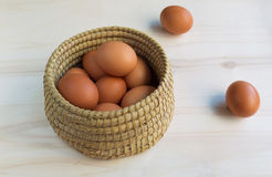 Fresh eggs. Fresh organic eggs in a basket on a wooden surface stock photo