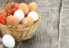Fresh eggs and tomatoes Stock Photos
