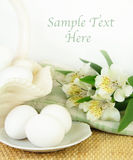 Fresh Eggs With White Flowers Stock Photo