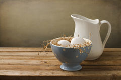 Fresh eggs with white jug Royalty Free Stock Photos