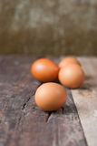 Fresh eggs on a wooden Royalty Free Stock Images
