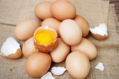 Fresh eggs on wooden background. Natural healthy food. And organic farming concept stock photos