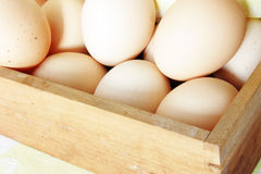 Fresh eggs in wooden box Royalty Free Stock Photography