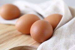 Fresh eggs. On wooden choping block Royalty Free Stock Image