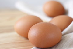 Fresh eggs. On wooden choping block Stock Image