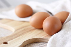 Fresh eggs. On wooden choping block Stock Images