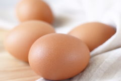 Fresh eggs. On wooden choping block Royalty Free Stock Photo