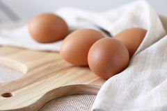 Fresh eggs. On wooden choping block Stock Photos