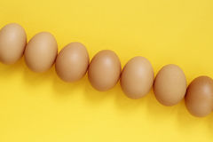 Fresh eggs. On yellow background Royalty Free Stock Photography