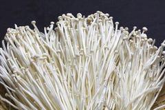 Fresh of enoki mushrooms Royalty Free Stock Image