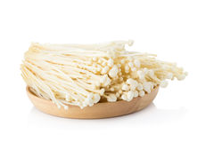 Fresh Enoki mushrooms on white background Stock Photos