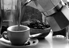 Fresh espresso. Pourd into a cup.  Steam rising from the cup.(Grainy Royalty Free Stock Image